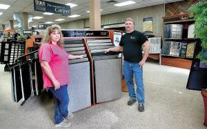 DeeDee and Greg Ricketts inside The Floor Shop.